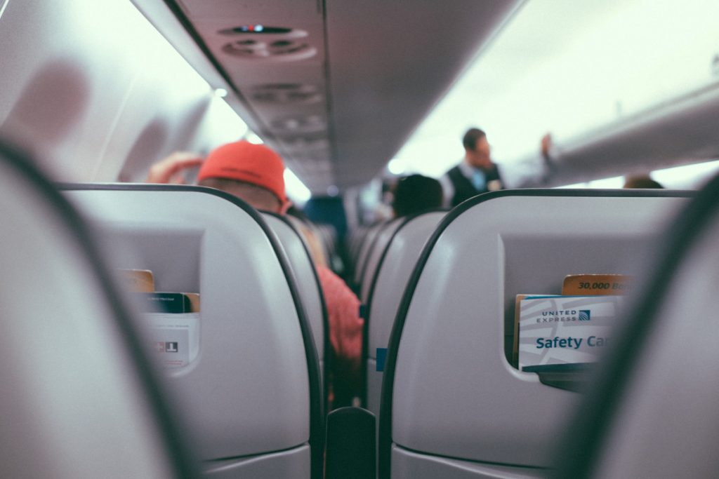How To Fly Comfortably Even If You Get The Middle Seat